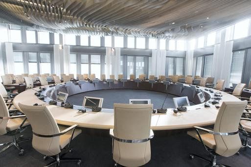Chairs and screens sit in the Governing Council conference hall inside the new headquarters of the European Central Bank (ECB) in Frankfurt, Germany, on Friday, Feb. 13, 2015.