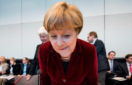 Chancellor Angela Merkel arrives for a meeting of the Christian Democratic Union's parliamentary group in Berlin yesterday, following news of economic improvements. Photo: Getty Images
