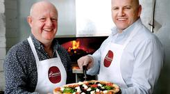 Sean Gallagher pictured with Derek Bresnan of Brezzis Wood Fired Pizza in Portmarnock, Co. Dublin. Photo: Gerry Mooney