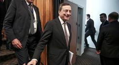 Mario Draghi, president of the European Central Bank (ECB), leaves after attending a news conference following an ECB meeting in Nicosia, Cyprus, on Thursday, March 5, 2015.