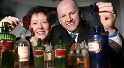 POTION POWER: Ann McGee and Sean Gallagher with some artefacts from the fast-changing world of pharma. Photo: Gerry Mooney