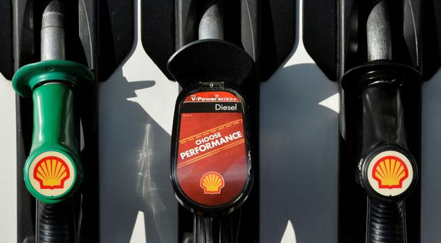 Shell logos are seen on fuel pumps at a petrol station in west London, in this January 29, 2015 file photo. Royal Dutch Shell is in advanced talks to buy BG Group in the first oil super-merger since early 2000s to extend its global lead in gas production a