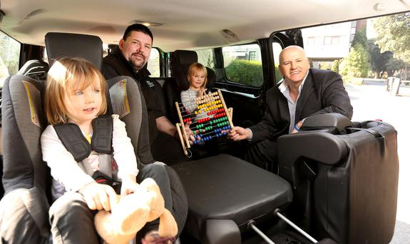 Child Friendly Taxi: Sean Gallagher with Simon Connellan and four-year-old Thea Sykes (right) and her sister two-year-old Fleur. Photo: Gerry Mooney