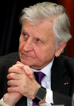 Kiss of death: Jean-Claude Trichet - sporting his own wearable Apple device