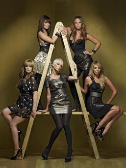 Nadine Coyle, pictured bottom right, with members of the hit pop group