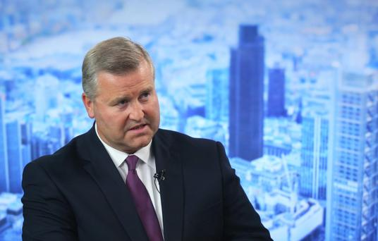 Albert Manifold, chief executive officer of CRH Plc, speaks during a Bloomberg Television interview in London, U.K., on Tuesday, Aug. 19, 2014. CRH, the biggest company on the benchmark Irish stock index, said it may spend as much as 1.5 billion euros ($2 billion) on acquisitions over the next 18 months, after the building-materials supplier reported a 27 percent increase in first-half earnings. Photographer: Chris Ratcliffe/Bloomberg