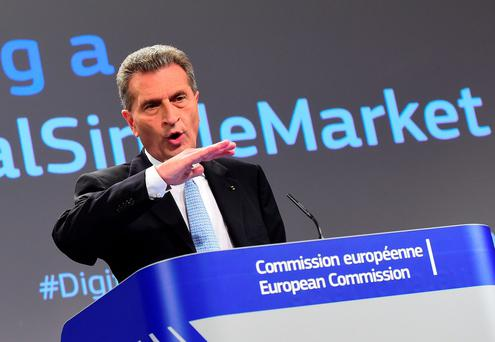 Gunther Oettinger holds a press conference on the Digital Single Market at the European Commission in Brussels, on May 6, 2015. Brussels formally opened an anti-trust inquiry into Europes's online shopping marketplace amid concerns about how websites such