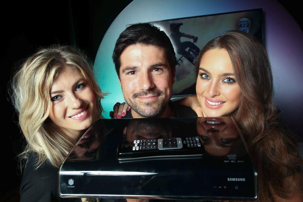 Models Felicia Torica and Roz Purcell with UPC brand ambassador Craig Doyle at the launch of the company's Horizon TV boxes