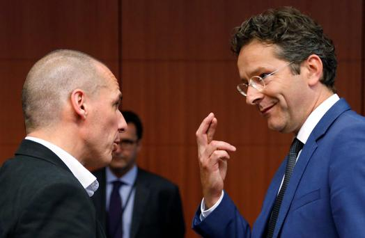 Dutch Finance Minister and Eurogroup chairman Jeroen Dijsselbloem crosses his fingers as he listens to Greece's Finance Minister Yanis Varoufakis (L) during euro zone finance ministers meeting in Brussels, Belgium, May 11, 2015. REUTERS/Francois Lenoir TPX IMAGES OF THE DAY