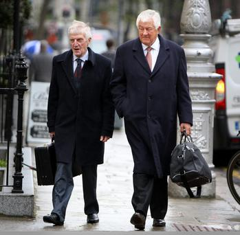 IT'S A DODDLE: Former Governors of Bank of Ireland Laurence Crowley (left) and Richard Burrows arrive at Leinster House last week. Photo: Tom Burke