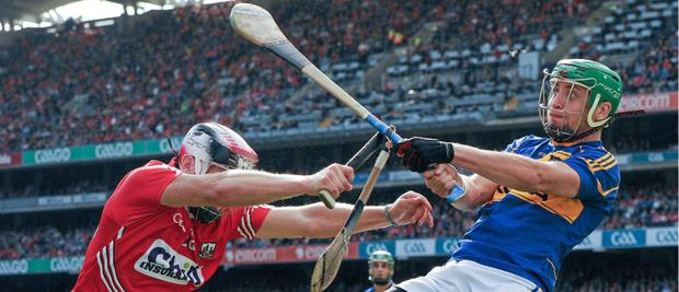 Clash of the ash: Cork and Tipp players wearing Mycro helmets
