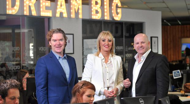 WOW FACTOR: Husband-and-wife team Dan and Linda Kiely, above with Sean Gallagher, have built up Voxpro into a global success story