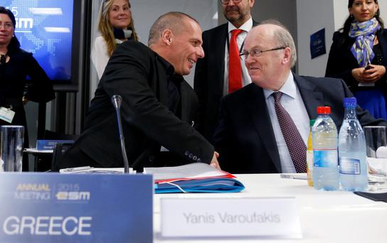 Greek Finance Minister Yanis Varoufakis shakes hands with Michael Noonan ahead of the meeting in Luxembourg yesterday