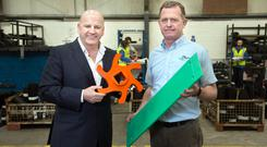 Sean Gallagher and Charlie Dolan examine some prototypes at Irish Waterjet Profile in Kilbeggan, Co Westmeath. Photo: Tony Gavin