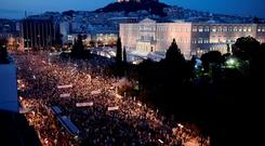 Protesters gather in front of the Greek parliament in Athens last night, carrying banners calling for a No vote in the forthcoming referendum on bailout conditions set by the country's creditors
