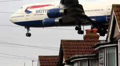 A Boeing 747 on approach to Heathrow Airport over the suburb Feltham. Photographer: Jason Alden/Bloomberg News
