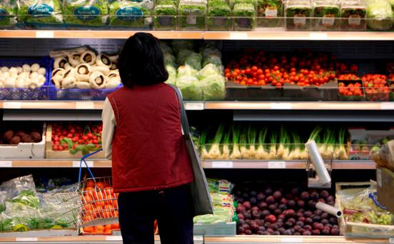 A woman in a Tesco store. Tesco has 25.1pc of the market