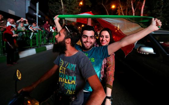 Iranians celebrate in Tehran this week after the nation's nuclear negotiating team struck a deal with world powers in Vienna. Photo: Getty Images