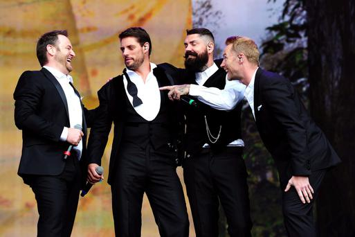 Boyzone (from left to right) Mikey Graham, Keith Duffy, Shane Lynch and Ronan Keating performing