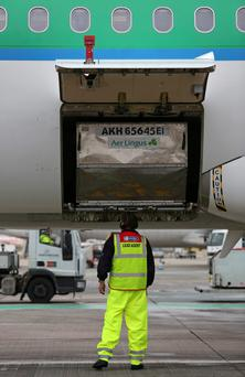 Aer Lingus operations at Gatwick. The airline will have to surrender five slots at the London airport.