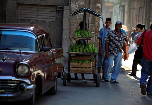 Local Cubans on the streets of historic, but crumbling, Havana