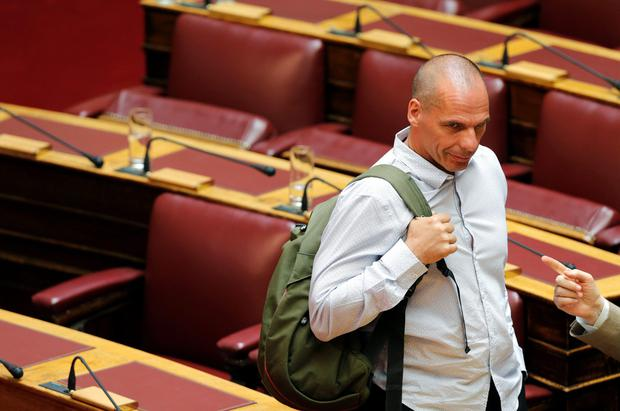 Greece's energy minister and head of the far-left flank of ruling Syriza party Panagiotis Lafazanis (R) points while talking with former Greek Finance Minister Yanis Varoufakis during a parliamentary session in Athens, Greece July 15, 2015. Prime Minister Alexis Tsipras battled to win lawmakers' approval on Wednesday for a bailout deal to keep Greece in the euro and avoid bankruptcy, as the IMF pressured Greece's creditors to provide massive debt