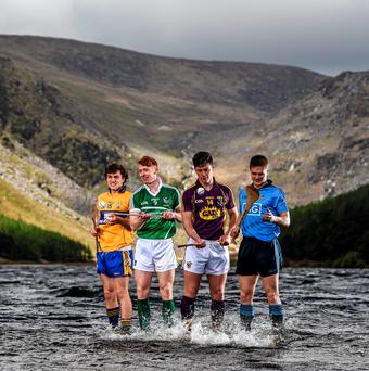Shane O'Donnell, Clare, Cian Lynch, Limerick, Conor McDonald, Wexford, and Cian O'Callaghan, Dublin, at the launch of the 2015 Bord Gáis Energy GAA Hurling U-21 All-Ireland Championship at Glendalough, Co Wicklow, in May