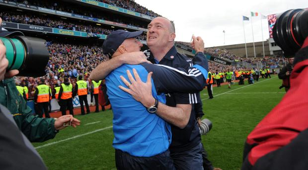 Pat Gilroy, right, celebates in 2011 as Dublin team win their first senior All-Ireland title since 1995