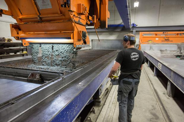 A German factory worker uses a control panel to disperse premixed concrete, manufactured by Holcim. Photo: Bloomberg