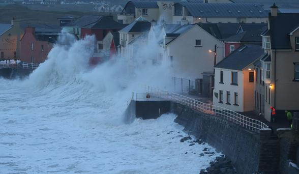 A wave pounds Lahinch in Co Clare during the 2014 storms. Photo: PA