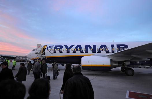Passengers board a Ryanair airplane at Barajas airport in Madrid, Spain