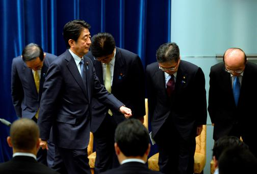 Under-fire Prime Minister Shinzo Abe, pictured left, had hoped for better economic data to silence his critics