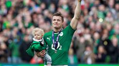Family man: Brian O'Driscoll with his daughter Sadie at his last Six Nations match in the Aviva last year