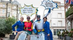 Ryanair chief executive Michael O'Leary dressed as Robin and Car Trawler boss Mike McGearty dressed as Batman in London yesterday to announce the new partnership between the two companies