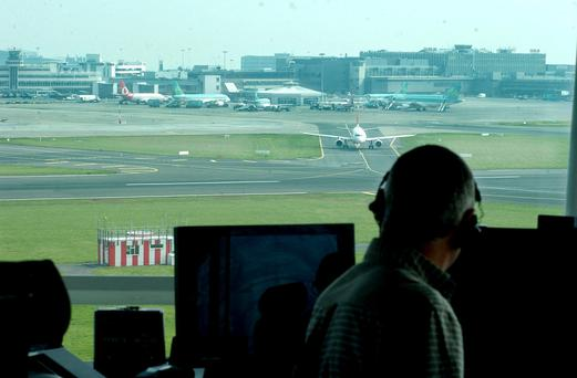 A surface movement controller works in the watch tower of the Air Traffic Control Centre at Dublin Airport