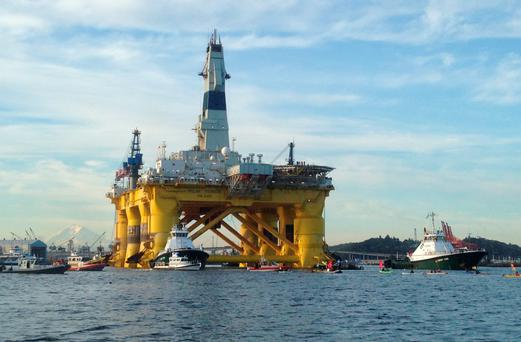 Kayakers trying to block the departure of the Shell Oil Polar Pioneer rig platform to be used in offshore drilling operations in Alaska as it moved from Elliott Bay in Seattle, Washington
