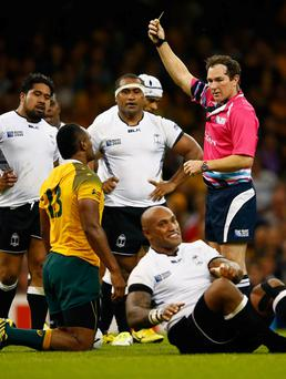 Referee Glen Jackson shows the yellow card to Australia's Kuridrani in the Rugby World Cup.