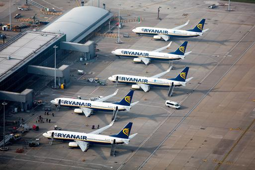 Passenger aircraft operated by Ryanair sit on the tarmac at London Stansted Airport. Photo: Bloomberg