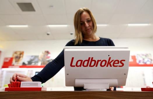 Investors are expected to vote in favour of the deal to merge Ladbrokes, above, with Coral. Photo: Chris Ratcliffe/Bloomberg