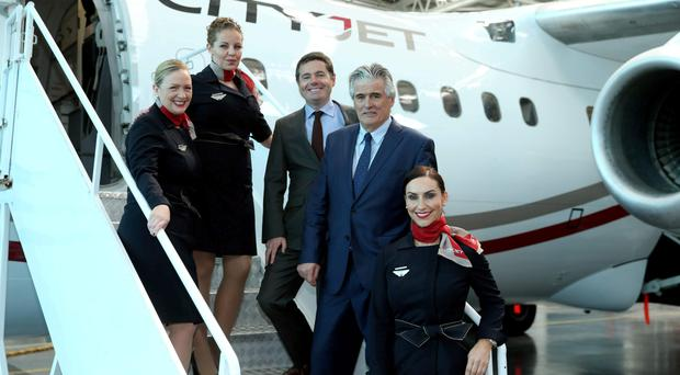 Executive chairman Pat Byrne pictured with Transport Minister Paschal Donohoe and cabin crew earlier this year. Photo: Jason Clarke.