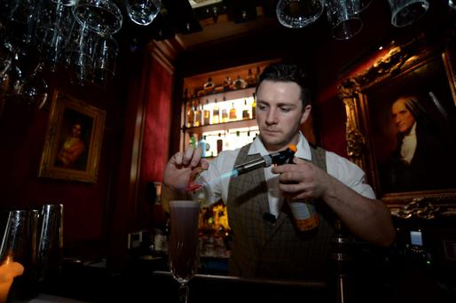 A bar worker at Peruke and Perwig Photo:Caroline Quinn