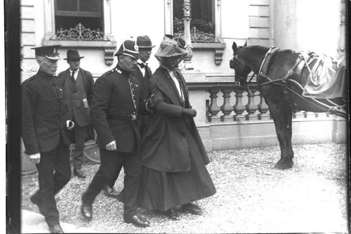Campaign: A suffragette is arrested by an RIC policemen for protesting outside the Mansion House, Dublin in 1914. Image courtesy of RTÉ Stills Library © RTÉ