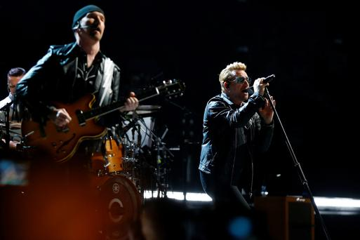 Irish band U2 singer Bono (R) and guitarist The Edge (L)perform on stage at the Bercy Accordhotels Arena in Paris on December 6, 2015. / AFP / THOMAS SAMSONTHOMAS SAMSON/AFP/Getty Images