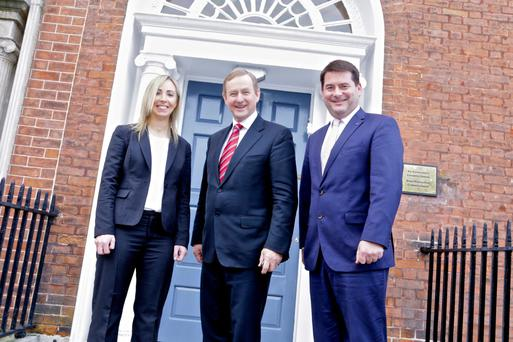 Data Commissioner Helen Dixon with Taoiseach Enda Kenny and Data Minister Dara Murphy at the new offices yesterday