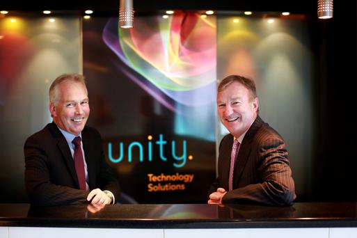 New chief executive officer Fin O'Driscoll, left, with Unity Technology Solutions chairman David Hargaden