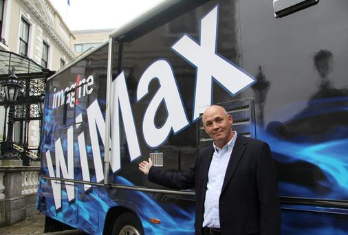 Imagine CEO Sean Bolger poses with the WiMAX coach
