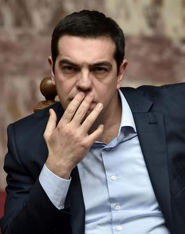 Despite Greek Prime Minister Tsipras assuring savers that his country's banks are now among the most adequately capitalised in Europe, Greeks are still unwilling to put their savings in the banks Photo: Aris Messinis