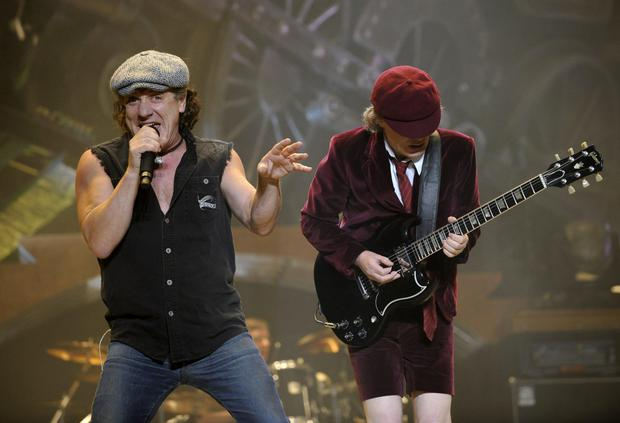.AC/DC lead singer Brian Johnson, left, and lead guitarist Angus Young