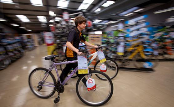 Cycling-related sales a bright spot for the retailer as warmer December weather affected car-linked products. Photo: Jason Alden/Bloomberg