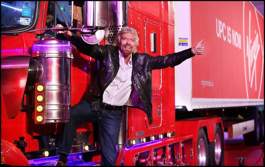 Richard Branson arriving by juggernaut at the RDS for the announcement that UPC Ireland is to become Virgin Media.
